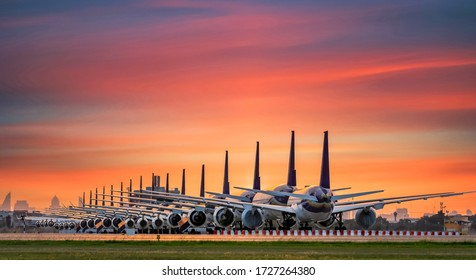 Commercial airplane parking at the airport are stopped effect by covid-19 pandemic around the world economic down crisis, Airplanes are parking at maintenance area because of COVID-19 travel alert