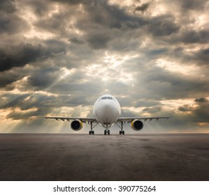 Commercial airplane with storm clouds