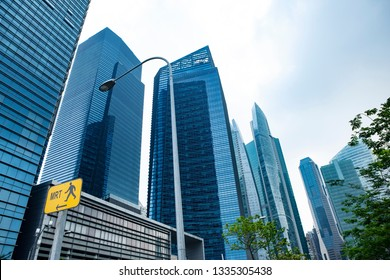 Commercial building in business disctrict of Singapore at noon