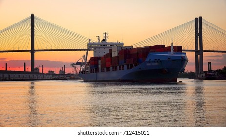 A commercial cargo ship as it leaves the Port of Savannah in Georgia at sunset
