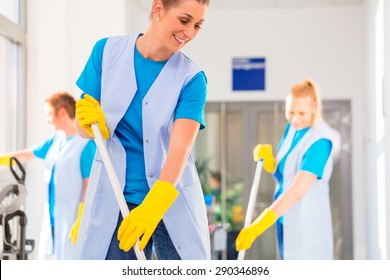 Commercial cleaning brigade working mopping the floor
