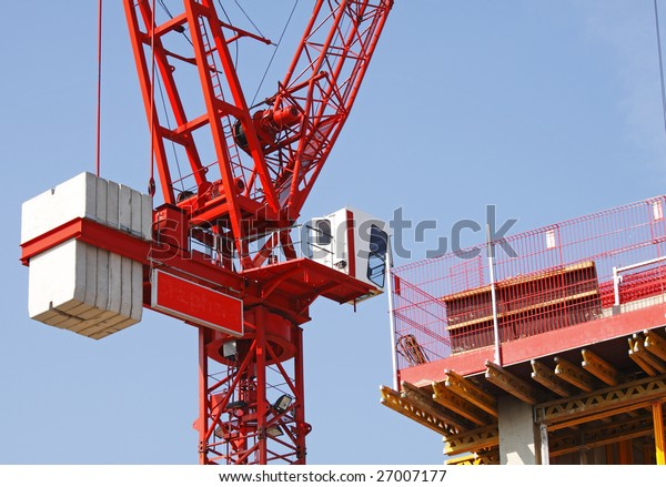 Commercial Construction Site with scaffolding and Crane