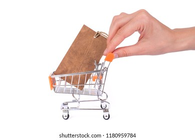 Commercial consumerism concept. Side profile close up photo of pushcart with pricetag inside hand holing pushing cart isolated on white background copyspace empty place for text