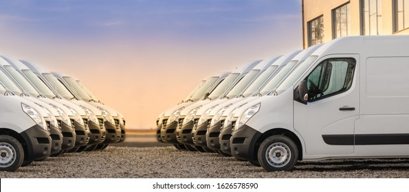 commercial delivery vans parked in two rows. Transporting service company.