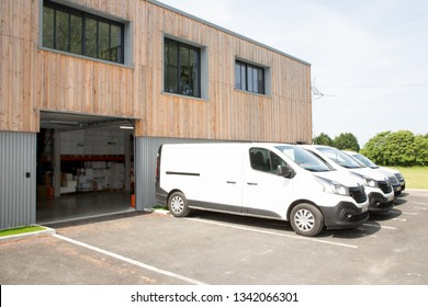 commercial delivery vans in parking place of transporting carrier shipping company