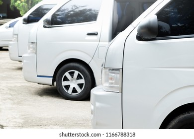 Commercial delivery vans in row at parking place of transport carrier shipping service company.