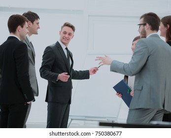 commercial Director and business team discussing a new business