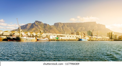 Commercial docks in Cape Town port with Table Mountain in the background