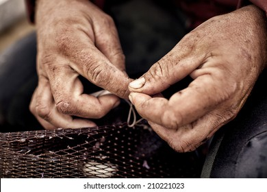 Commercial fisherman repairing his Eel nets