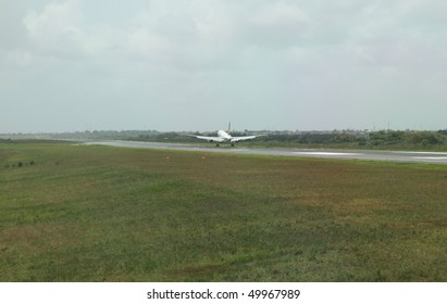 commercial jet airplane landing on the runway