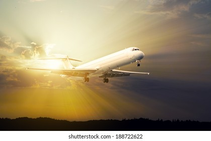 commercial jet airplane at sunset