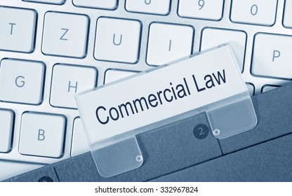 Commercial Law - folder with text on computer keyboard