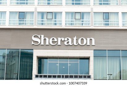 Commercial outdoor sign of Sheraton Hotel on the exterior facade of new building prepared for opening. January - 22. 2018. Novi Sad, Serbia. Editorial image