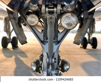 Commercial passenger jet aircraft plane nose landing gear undercarriage lights