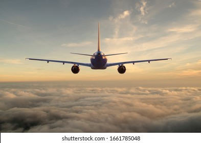 commercial passenger plane flies above the clouds towards the setting sun