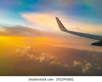 A commercial passengers plane is flying above the clouds