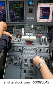 Commercial pilot in the cockpit do an inspection before flight. View of cockpit instrument panel area.