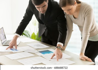 Commercial residential interior design services, serious focused professional designers team working on project, discussing functional space creation, decoration ideas, choosing color stylish scheme