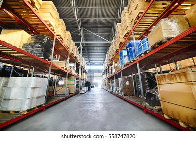Commercial warehouse. Long shelves with a variety of boxes and containers.