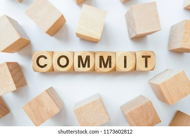 Commit word on wooden cubes