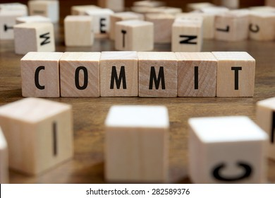 commit word written on wood block