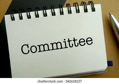 Committee memo written on a notebook with pen