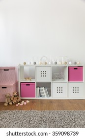 Commode with rose boxes in child's room