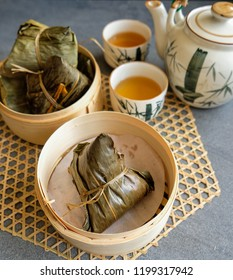 Common breakfast meals in Malaysian eateries / Chang aka Glutinous Rice Dumplings with Chinese Tea / After a hearty meal, Chinese tea helps to dilute the oil and helps in digestion