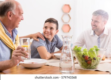 Common family meal with father and grandpa
