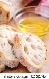 Common Italian appetiser; sliced baguette served with olive oil