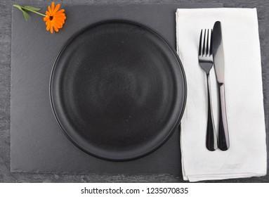 Common marigold and table setting on slate