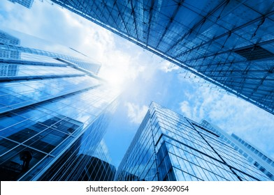 Common modern business skyscrapers, high-rise buildings, architecture raising to the sky, sun. Concepts of financial, economics, future etc. - Shutterstock ID 296369054