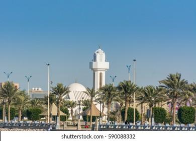 A common small mosque, Al Essa and Al Dowayan Mosque, with palm tree in the corniche coastal park in Dammam, Kingdom of Saudi Arabia