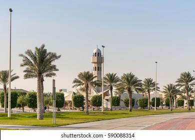 A common small mosque with palm tree in the Dammam Corniche coastal park in Dammam, Kingdom of Saudi Arabia