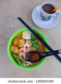 Common street food for breakfast and lunch / Nyonya Laksa / Taste different from curry laksa and less spicy but a distinct taste with assam laksa minus the sourness