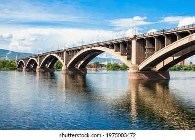 Communal bridge is a automobile and pedestrian bridge across the Yenisei river in Krasnoyarsk, Russia