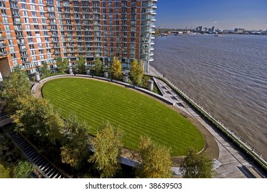 communal garden on riverside of thames, docklands, london