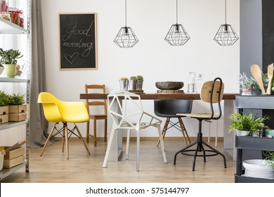 Communal table in bright and spacious dining room