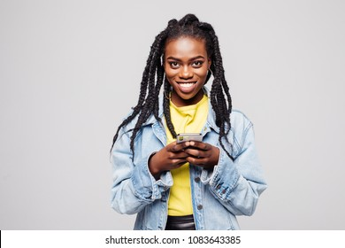 Communicating woman with afro hairstyle using mobile phone over white