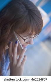 Communication. Beautiful woman with smartphone