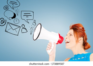 communication concept - redhead woman with megaphone over blue background