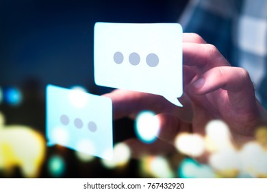 Communication, dialog, conversation on an online forum and internet chatting concept. Business man or social media consultant holding speech bubbles in futuristic modern abstract space.