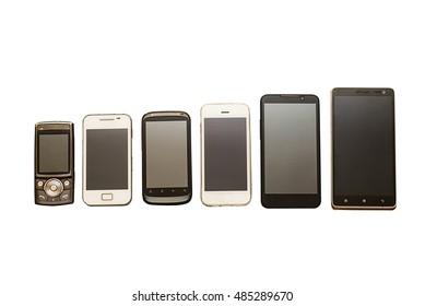 通信演变,技术演变:在白色背景下收集不同类型的移动设备,移动电话,新旧电话的演变