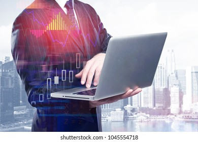 Communication and growth concept. Businessman using laptop on abstract city background with forex chart. Double exposure
