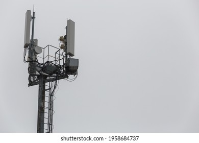 communication and gsm, wcdma, hspda and other 3g, 4g standarts tower close-up in cloudy weather
