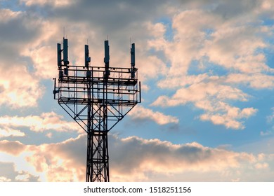 communication mast with antennas against a cloudy sky
