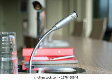 Communication, media or news concept: close-up of a isolated microphone in an office with notekook and pencel- selective focus, lots of copyspace