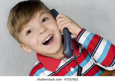 Communication - Portrait of little child in T-shirt talking to an telephone