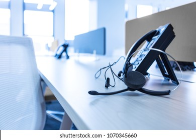 Communication support, call center and customer service help desk. VOIP headset on desk.
