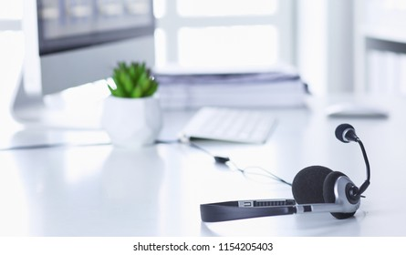 Communication support, call center and customer service help desk. VOIP headset on laptop computer keyboard